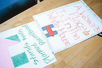 Handwritten campaign signs are seen before former Secretary of State and Democratic presidential candidate Hillary Rodham Clinton speaks at a rally at Nashua Community College in Nashua, New Hampshire, on Tues. Feb. 2, 2016. Former president Bill Clinton also spoke at the event. The day before, Hillary Clinton won the Iowa caucus by a small margin over Bernie Sanders.