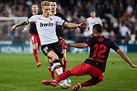 14th February 2020; Mestalla, Valencia, Spain; La Liga Football,Valencia versus Atletico Madrid; Mouctar Diakhaby of Valencia CF takes on Renan Lodi of Atletico Madrid