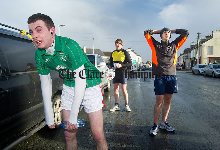 Robert Daly and Shane Keane recover after the West Clare Mini Marathon from Carrigaholt to Kilkee. Photograph by John Kelly.