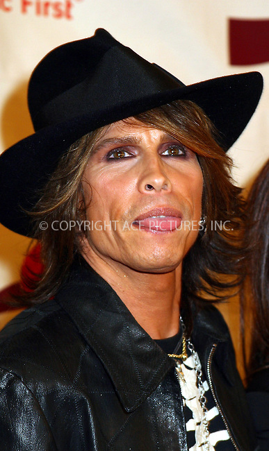 Aerosmith frontman Steven Tyler and his family arriving at 2002 VH1/Vogue Fashion Awards at Radio City Misic Hall. New York, October 15, 2002. Please byline: Alecsey Boldeskul/NY Photo Press.   ..*PAY-PER-USE*      ....NY Photo Press:  ..phone (646) 267-6913;   ..e-mail: info@nyphotopress.com