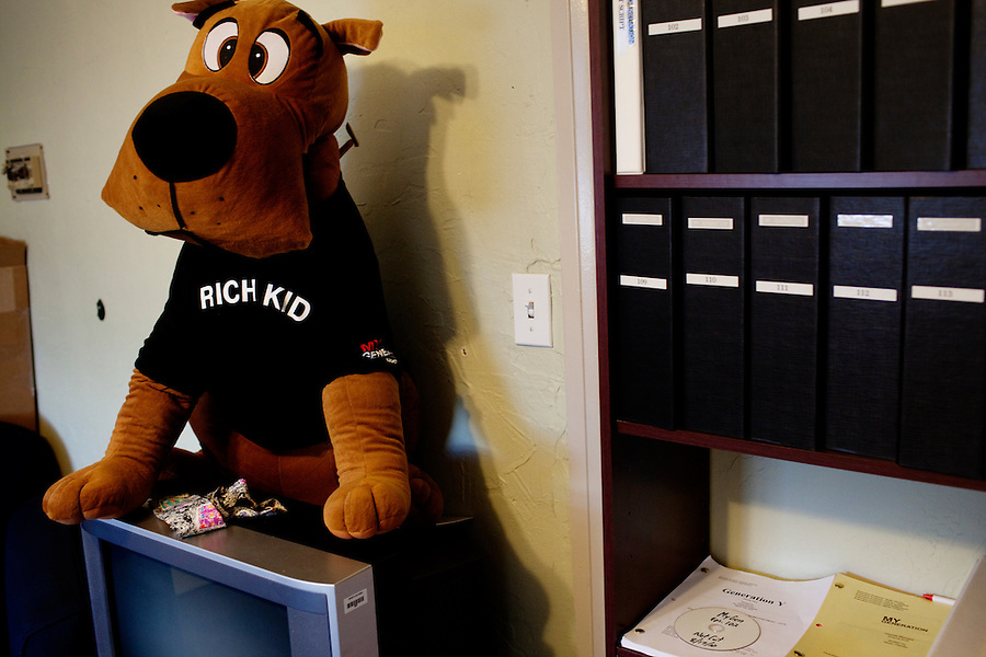 CREDIT: Daryl Peveto / LUCEO ..Los Angeles, California, September 28, 2010 - A stuffed dog sports a t-shirt for ABC Television's mockumentary My Generation next to a shelf of manuscripts for the show at the show's office in the Clune Bldg. at Raleigh Studios in West Hollywood. .