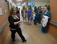 NWA Democrat-Gazette/ANDY SHUPE<br /> Charity Tisdale (left), assistant chief of environmental management services for Veterans Health Care System of the Ozarks in Fayetteville, leads a tour Tuesday, Sept. 11, 2018, after a dedication ceremony for the Leroy Pond Residential Treatment Facility in Fayetteville. The facility offers 20 beds 20-beds and inpatient care for veterans who are facing substance abuse and co-occurring mental illness and homelessness.