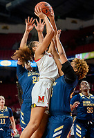 COLLEGE PARK, MD - NOVEMBER 20: Ariel Stephenson #25 and Kayla Mokwuah #24 of George Washington defend against Shakira Austin #1 of Maryland during a game between George Washington University and University of Maryland at Xfinity Center on November 20, 2019 in College Park, Maryland.