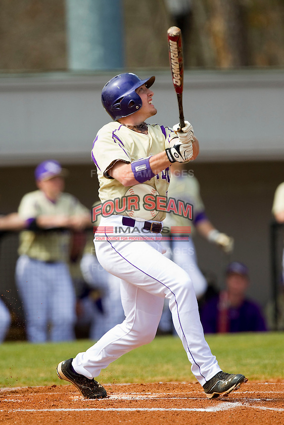 Cody Jones (12) of the Western Carolina Catamounts follows through on his swing against the Davidson Wildcats at Wilson Field on March 10, 2013 in Davidson, North Carolina.  The Catamounts defeated the Wildcats 5-2.  (Brian Westerholt/Four Seam Images)
