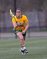 University of Vermont defender Taylor Pedersen (10) brings the ball forward. Boston College defeated University of Vermont, 15-9, at Newton Campus Field, April 4, 2012.