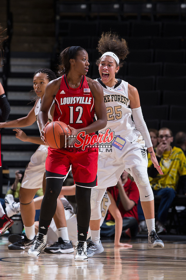 Shawnta' Dyer (12) of the Louisville Cardinals is guarded by Dearica Hamby (25) of the Wake Forest Demon Deacons during first half action at the LJVM Coliseum on January 11, 2015 in Winston-Salem, North Carolina.  The Cardinals defeated the Demon Deacons 79-68.  (Brian Westerholt/Sports On Film)