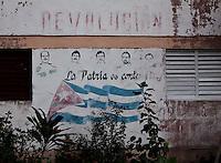 La Fe, 30 de Maio de 2011..Detalhe de mural em homenagem aos Cinco de Cuba, cubanos presos nos EUA por investigarem possiveis atentados terroristas contra o pais...Detalle del mural en honor a los Cinco Cubanos, presos cubanos en los EE.UU. para investigar posibles ataques terroristas contra el país...Foto: LEO DRUMOND / NITRO