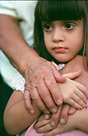 hand of great grandmother hugging of 4 year old Cuban girl