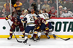 ST PAUL, MN - APRIL 7: Jade Miller #26 and Matt Anderson #21 of the Minnesota-Duluth Bulldogs battle Jack Jenkins #28 and Mike O'Leary #19 of the Notre Dame Fighting Irish for the puck during the Division I Men's Ice Hockey Semifinals held at the Xcel Energy Center on April 7, 2018 in St Paul, Minnesota. (Photo by Carlos Gonzalez/NCAA Photos via Getty Images)