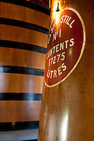 A detail of an antique wooden cask used to store whisky during the distillery process