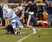 Pitt long snapper David Murphy tackles North Carolina punt returner Ryan Switzer (3). The North Carolina Tar Heels football team defeated the Pitt Panthers 26-19 on Thursday, October 29, 2015 at Heinz Field, Pittsburgh, Pennsylvania.