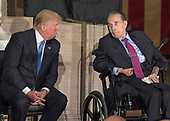 United States President Donald J. Trump, left, speaks with former US Senator Bob Dole (Republican of Kansas), right, during a Congressional Gold Medal ceremony honoring Dole in the Rotunda of the US Capitol on Wednesday, January 17, 2017.  Congress commissioned gold medals as its highest expression of national appreciation for distinguished achievements and contributions.  Dole served in Congress from 1961 through 1996, was the Senate GOP leader from 1985 through 1996, and was the 1996 Republican Party nominee for President of the United States.<br /> Credit: Ron Sachs / CNP