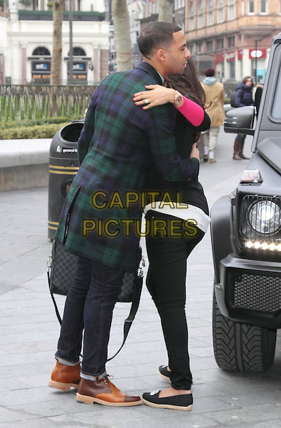 Marvin Humes arrives for his 1st Day at work at Capital FM, Leicester Square, London, England..28th March 2013.jls full length green blue check plaid tartan jacket coat jeans denim briefcase jeans denim brown shoes side profile hug embrace .CAP/ROS.©Steve Ross/Capital Pictures..