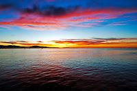 The sun rises over the Santa Barbara Harbor one January morning, California.