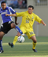 6 August 2005:  Eric Vasquez of the Crew in action against Ricardo Clark of the Earthquakes at Spartan Stadium in San Jose, California.   Earthquakes defeated Crew, 2-1.   Credit: Michael Pimentel / ISI