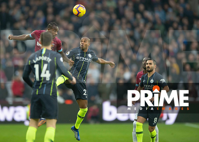 Michail Antonio of West Ham United beats Fernandinho of Manchester City to the ball during the Premier League match between West Ham United and Manchester City at the Olympic Park, London, England on 24 November 2018. Photo by Vince Mignott / PRiME Media Images.