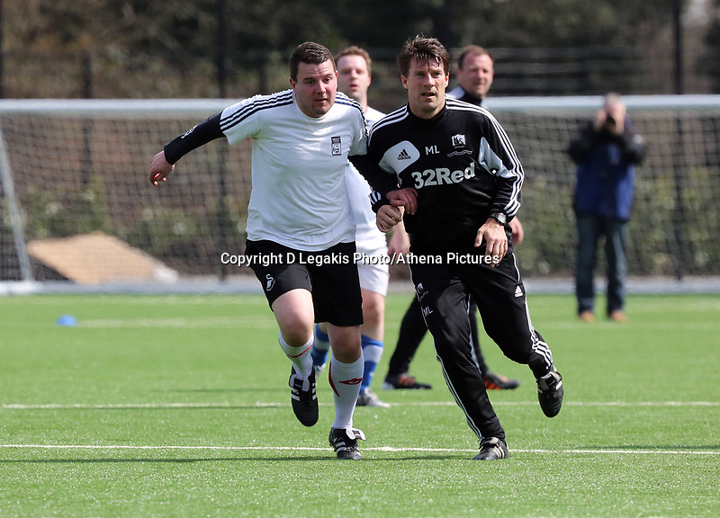 Thursday 11 April 2013<br /> Pictured L-R: South Wales Evening Post sports reporter Gareth Vincent against Michael Laudrup.<br /> Re: Friendly game, Swansea City FC coaching staff v sports reporters at the Swansea City FC training ground. Final score 10-4.