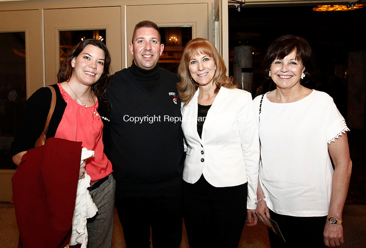 Waterbury, CT- 27 March 2014-032714CM12- Left to right,  Jessica Tinsley of West Hartford, John Rocchi of Watertown, Jeannine Derouin of Watertown and Kathleen McNamara of Waterbury during the CONNfection event at the Palace Theater, in Waterbury Thursday night. The event is supported by the Waterbury Arts & Tourism Commission, the Waterbury Neighborhood Council, The Good Life Wine & Spirits and 1249 winebar.   Christopher Massa Republican-American