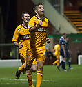 Motherwell's Keith Lasley (14) celebrates after he scores Motherwell's third goal...