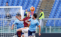 Calcio, Serie A: Roma vs Lazio. Roma, stadio Olimpico, 8 novembre 2015.<br /> Roma's Edin Dzeko, center, and Lazio's Santiago Gentiletti fight for the ball during the Italian Serie A football match between Roma and Lazio at Rome's Olympic stadium, 8 November 2015.<br /> UPDATE IMAGES PRESS/Riccardo De Luca