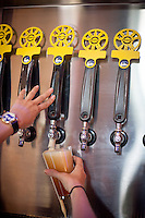 Copyright Justin Cook | July 24, 2013<br /> <br /> A bartender pours a beer at Crank Arm Brewery in Raleigh, N.C.