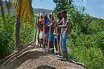 A year after Hurricane Matthew ravaged parts of Haiti, people tamp down a dike they built in the community of Bassin Hady, a village in the country's drought-stricken northwest where seven people died during the storm. In the wake of the hurricane, residents here constructed a series of earthen dikes that catch and hold rain water, preventing soil erosion and providing water for expanded agriculture. They did it with help from Lutheran World Relief, one of several members of the ACT Alliance that are helping Haitians build resiliency as they rebuild from the storm.