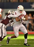 STAFF PHOTO BEN GOFF  @NWABenGoff -- 09/27/14 Arkansas running back Jonathan Williams breaks the tackle of Texas A&M free safety Armani Watts during the fourth quarter of the Southwest Classic at AT&T Stadium in Arlington, Texas on Saturday September 27, 2014.