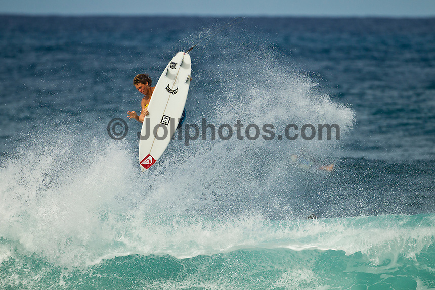 North Shore/Oahu/Hawaii (Friday, November 25, 2011) – Jesse Mendes (BRA) in a free surfing session at Rocky Point in 3'-4' side shore trades. . Photo: joliphotos.com