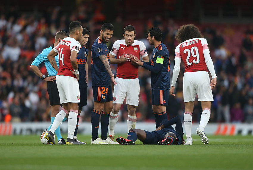 Arsenal's Sokratis Papastathopoulos pleads his innocence after his challenge on Valencia's Mouctar Diakhaby<br /> <br /> Photographer Rob Newell/CameraSport<br /> <br /> UEFA Europa League Semi-final 1st Leg - Arsenal v Valencia - Thursday 2nd May 2019 - The Emirates - London<br />  <br /> World Copyright © 2018 CameraSport. All rights reserved. 43 Linden Ave. Countesthorpe. Leicester. England. LE8 5PG - Tel: +44 (0) 116 277 4147 - admin@camerasport.com - www.camerasport.com