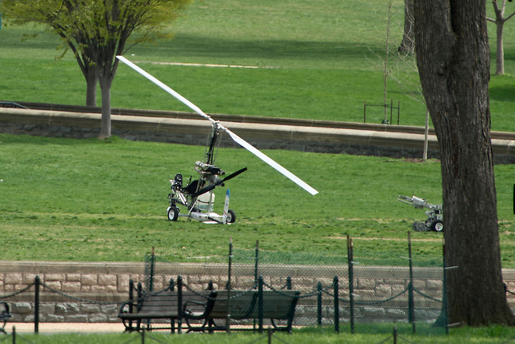 UNITED STATES - APRIL 15: A man was arrested after landing a  gyrocopter on the West Lawn of the U.S. Capitol on Wednesday, April 15, 2015. The small helicopter was painted with a U.S. Postal Service logo. (Photo By Bill Clark/CQ Roll Call)