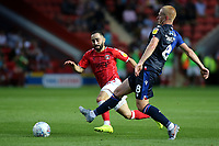 Ben Watson of Nottingham Forest passes the ball forward as Charlton's Erhun Oztumer looks on during Charlton Athletic vs Nottingham Forest, Sky Bet EFL Championship Football at The Valley on 21st August 2019