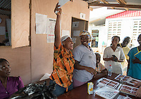 Occidental College professor Mary Beth Heffernan works on her PPE Portrait Project with health care workers at the ELWA II ETU (Ebola treatment unit) in Monrovia, Liberia on Wednesday, March 4, 2015. The ETU, operated by ELWA Hospital, was the first to open in Monrovia. Professor Heffernan's project involves creating wearable portraits of health care workers who must wear PPE (personal protective equipment) when working with patients, for example, patients with Ebola. <br /> (Photo by Marc Campos, Occidental College Photographer) Mary Beth Heffernan, professor of art and art history at Occidental College, works in Monrovia the capital of Liberia, Africa in 2015. Professor Heffernan was there to work on her PPE (personal protective equipment) Portrait Project, which helps health care workers and patients fighting the Ebola virus disease in West Africa.<br />
