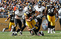 PITTSBURGH, PA - OCTOBER 16:  Heath Miller #83 of the Pittsburgh Steelers is brought down by members the Jacksonville Jaguars defense after catching a pass during the game on October 16, 2011 at Heinz Field in Pittsburgh, Pennsylvania.  (Photo by Jared Wickerham/Getty Images)