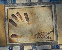 Hand print of the film star, John Travolta, outside the Palais des Festivals et des Congres, Cannes, France.