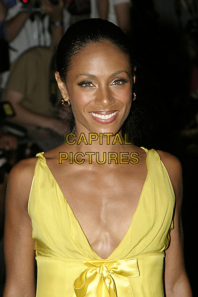 JADA PINKETT SMITH .Collateral UK premiere, UCI Empire, Leicester Square,  London, 2nd September 2004..half length long yellow satin dress bow ribbon.Ref: AH.www.capitalpictures.com.sales@capitalpictures.com.©Capital Pictures.