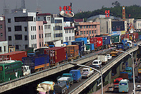 Container lorries clog the highway of Guangdong Province, China. Guangdong Province produces much of the world's goods, most of which exported overseas..15-JUL-04