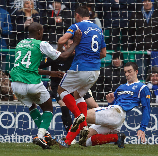Lee Wallace makes a last gasp tackle on Osbourne in the penalty box