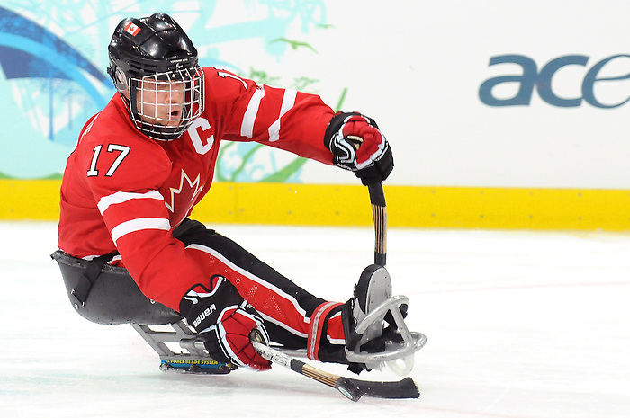 Jean, Labonté, plays the puck during action at a sledge hockey game during 2010 Paralympic Games in Vancouver. Credit: CPC/HC/Matthew Manor.