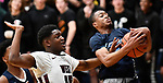 Belleville East guard ZJ Hamilton (right) pulls down a rebound as Belleville West forward Ruben Howell defends. Belleville West played Belleville East  in a Class 4A boys basketball semifinal game at Belleville East High School in Belleville, Illinois on Wednesday March 4, 2020. <br /> Tim Vizer/Special to STLhighschoolsports.com