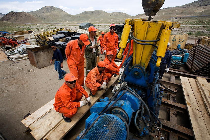 Chinese workers replace a drill at a Chinese-owned copper mine in Logar, Afghanistan, June 15, 2009.