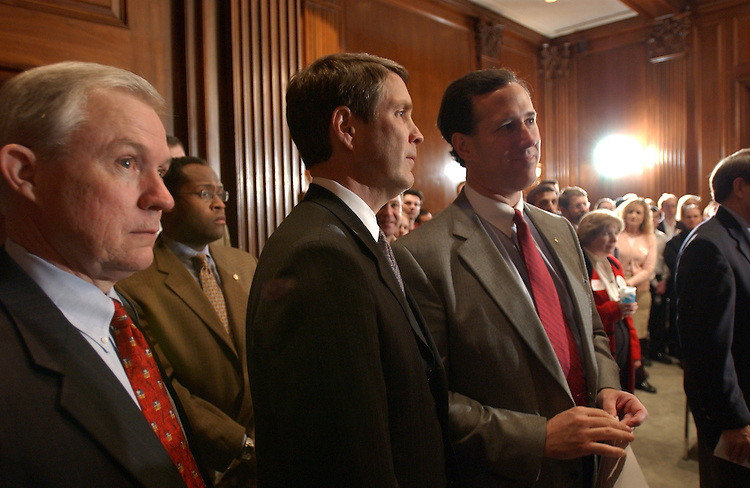 11/13/03.30-HOUR JUDICIAL NOMINATIONS DEBATE--At about 1:30 a.m., Sen. Rick Santorum, R-Pa., right, Senate Majority Leader Bill Frist, R-Tenn., and Sen. Jeff Sessions, R-Ala., left, during a press conference of several special interest groups and Sen. Lindsey Graham, R-S.C., in the Republican all-night press room, the Mansfield Room near the Senate floor..CONGRESSIONAL QUARTERLY PHOTO BY SCOTT J. FERRELL