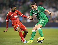 3rd September 2014; International Friendly, Republic of Ireland v Oman, Aviva Stadium, Dublin. <br /> Republic of Ireland's Stephen Ward with Mohammed Al Sivabi of Oman<br /> Picture credit: Tommy Grealy/actionshots.ie.