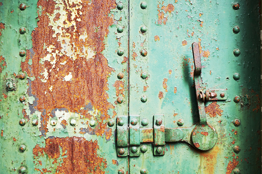 Closed rusty green steel door in concrete bunker, Artillery Hill, Fort Worden State Park, Port Townsend, Washington, USA