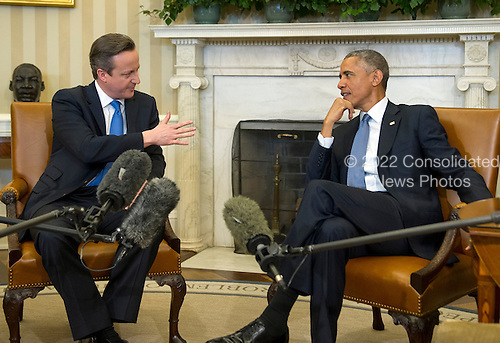 United States President Barack Obama meets Prime Minister David Cameron of the United Kingdom in the Oval Office of the White House in Washington, D.C. on Friday, January 16, 2015.<br /> Credit: Ron Sachs / Pool via CNP