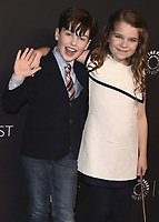 """HOLLYWOOD, CA - MARCH 21:  Iain Armitage and Raegan Revord at PaleyFest 2018 - """"Young Sheldon"""" at the Dolby Theatre on March 21, 2018 in Hollywood, California. (Photo by Scott KirklandPictureGroup)"""