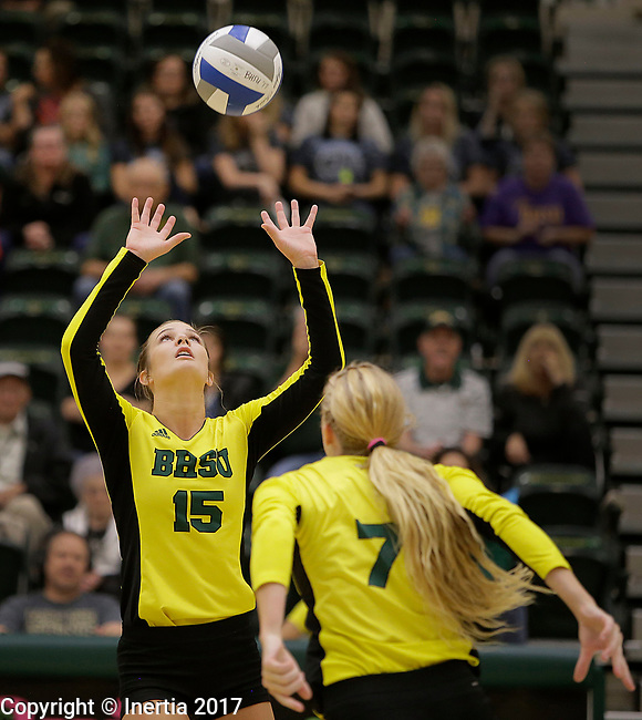 SPEARFISH, SD: SEPTEMBER 29:  Laurel Lech #15 of Black Hills State sets for teammate Fehrin Ward #7 during their college volleyball match against Colorado Mines Friday at the Donald E. Young Center in Spearfish, S.D.   (Photo by Dick Carlson/Inertia)