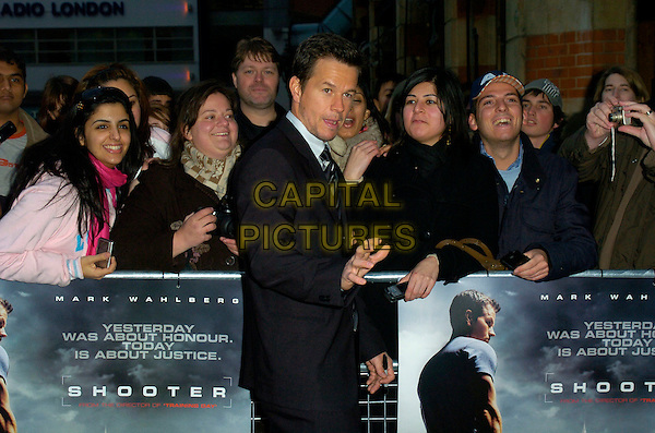 """MARK WAHLBERG.Attending the UK Premiere of """"Shooter"""",.Odeon West End,London, England,.March 29th 2007..half length black suit hand.CAP/CAN.©Can Nguyen/Capital Pictures"""