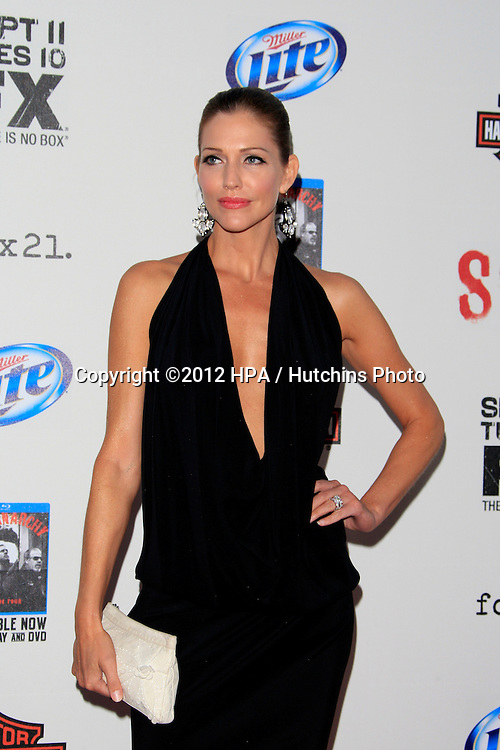 """LOS ANGELES - SEP 8:  Tricia Helfer arrives at the """"Sons of Anarchy"""" Season 5 Premiere Screening at Village Theater on September 8, 2012 in Westwood, CA"""