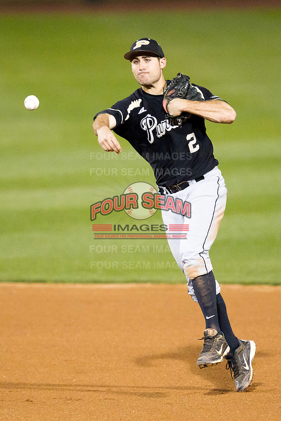 Eric Charles (2) of the Purdue Boilermakers throws to first base during a game against the Missouri State Bears at Hammons Field on March 13, 2012 in Springfield, Missouri. (David Welker / Four Seam Images)