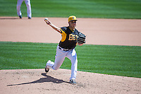 Chad Smith (26) of the Salt Lake Bees delivers a pitch to the plate against the Colorado Springs Sky Sox in Pacific Coast League action at Smith's Ballpark on May 24, 2015 in Salt Lake City, Utah.  (Stephen Smith/Four Seam Images)
